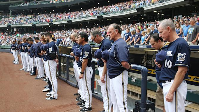 Cards win, Brewers SS Segura out after son's death