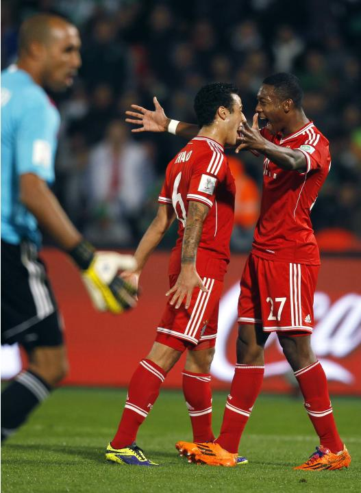 Thiago of Germany's Bayern Munich celebrates his goal against Morocco's Raja Casablanca with his team mate David Alaba during their 2013 FIFA Club World Cup final soccer match at Marrakech sta