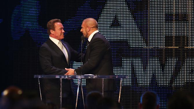 IMAGE DISTRIBUTED FOR WWE - Inductee Arnold Schwarzenegger, left, greets wrestler Triple H at the WWE Hall of Fame Ceremony, on Saturday, March 28, 2015 in San Jose, Calif. In his acceptance speech, Schwarzenegger cited influences from professional wrestling in his career as a bodybuilder, actor, and politician. (Don Feria/AP Images for WWE)