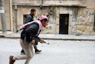 Syrian rebels run to take position in the Bustan al-Basha district in the northern city of Aleppo