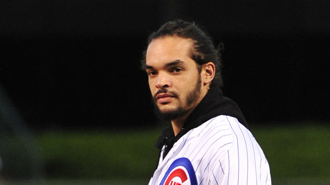 Chicago Bulls center Joakim Noah prepares to throw out the ceremonial first pitch before a baseball game between the Chicago Cubs and the Cincinnati Reds, Wednesday, Sept. 17, 2014, in Chicago