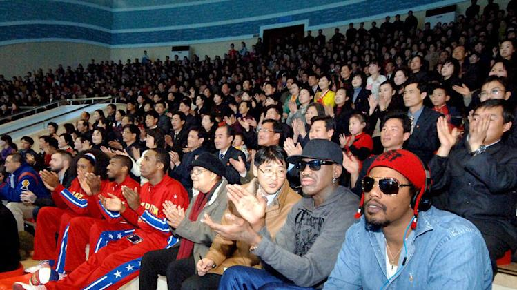 """In this image released by the Korean Central News Agency (KCNA) and distributed by the Korea News Service, former NBA star Dennis Rodman, second right in front row, visits a dolphin aquarium in Pyongyang in North Korea Friday, March 1, 2013.  Ending his unexpected round of basketball diplomacy in North Korea on Friday,  Rodman called leader Kim Jong Un an """"awesome guy"""" and said his father and grandfather were """"great leaders."""" (AP Photo/KCNA via KNS) JAPAN OUT UNTIL 14 DAYS AFTER THE DAY OF TRANSMISSION"""