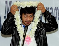 Philippine boxing icon Manny Pacquiao, pictured upon his arrival at Manila's international airport, on December 12, 2012
