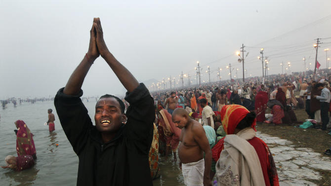 A Hindu devotee prays after a holy dip at Sangam,  the confluence of the Ganges, the Yamuna and the Saraswati rivers, during the Maha Kumbh festival at Allahabad, India, Monday, Feb. 11, 2013. The death toll from a stampede in a train station rose to 36 on Monday in the northern India city where millions of devotees had gathered for the Hindu festival that is one of the world's largest religious gatherings. (AP Photo /Manish Swarup)