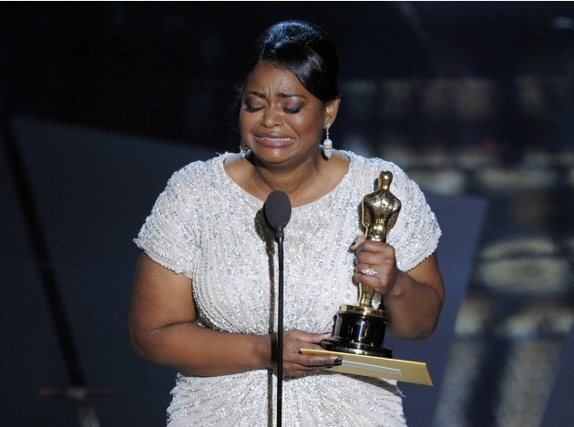 Octavia Spencer accepts the Oscar for best actress in a supporting role for The Help during the 84th Academy Awards on Sunday, Feb. 26, 2012, in the Hollywood section of Los Angeles. (AP Photo/Mark 