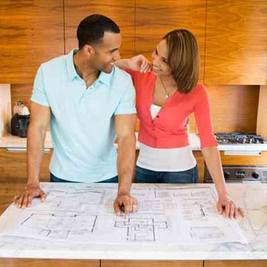 Husband-and-wife-looking-at-blueprints_web