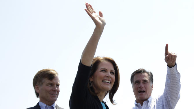 Republican presidential candidate, former Massachusetts Gov. Mitt Romney, right, Rep. Michele Bachmann, R-Minn., and Virginia Gov. Bob McDonnell, arrive at a campaign stop in Portsmouth, Va., Thursday, May 3, 2012. (AP Photo/Jae C. Hong)