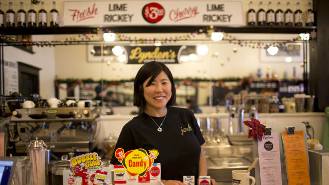 Co-owner of Lynden's Soda Fountain, Tobi Lynden, poses for a photo alongside candy cigarettes, in St. Paul, Minn., Wednesday, Dec. 26, 2012. Lynden's Soda Fountain was cited for selling candy cigarette's to kids. The candy cigarettes are no longer displayed or sold. (AP Photo/The Star Tribune, Jeff Wheeler)
