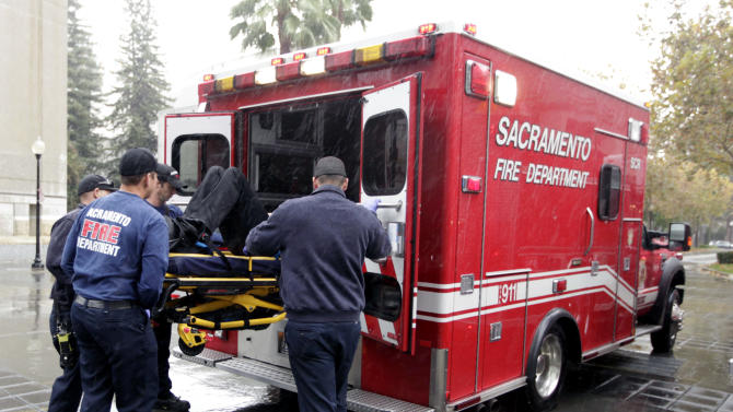 In this Nov. 8, 2012, photo, firefighters and paramedics from the Sacramento City Fire Department load a man, injured in a fall, into an ambulance in Sacramento, Calif.  Sacramento voters, who don't want to see a reduction in service such as public safety, approved a sales tax hike by a 2-to-1 ratio. During last week's elections, voters across the country opted to raise taxes to help their cities, counties and school districts. (AP Photo/Rich Pedroncelli)