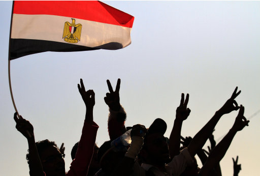 Protesters gesture,  as they demonstrate at Tahrir Square in Cairo, Egypt, Tuesday, July 12, 2011. Egypt's military rulers have sternly warned protesters against