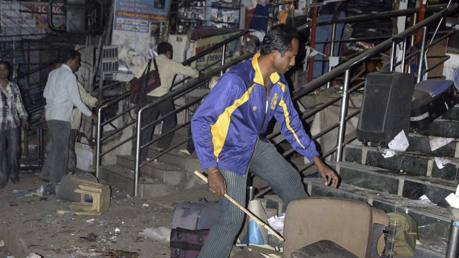 The scene of a blast at Dilsukhnagar in Hyderabad, India, Thursday, Feb.21, 2013. At least five people were killed Thursday in a pair of explosions in crowded areas of the southern Indian city of Hyderabad, police said. More were feared dead and injured. (AP Photo) INDIA OUT