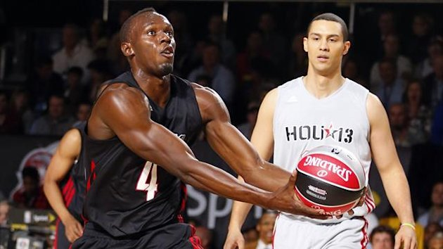Jamaican sprinter Usain Bolt (4) goes in for a lay-up during the NBA All-Star celebrity basketball game in Houston, Texas, February 15, 2013 (Reuters)