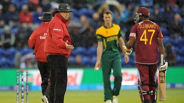 Dwayne Bravo, right, thought the umpires made the right call to take the players off