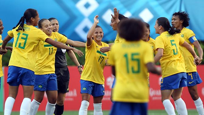 Brazil's  Debora De Oliveira (17) celebrates with teammates after scoring during a women's soccer match against Costa Rica at the Pan American Games in Guadalajara, Mexico, Thursday, Oct. 20, 2011. (AP Photo/Juan Karita)