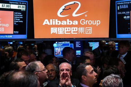 Traders work on the floor of the NYSE as they wait for a final price on the Alibaba Group Holding Ltd. IPO, in New York