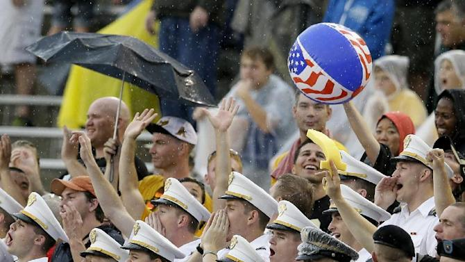 A light rain falls as Army cadets cheer on their team and toss a beach ball through the stands in the first half of an NCAA college football game against Louisiana Tech, Saturday, Sept. 28, 2013, in Dallas