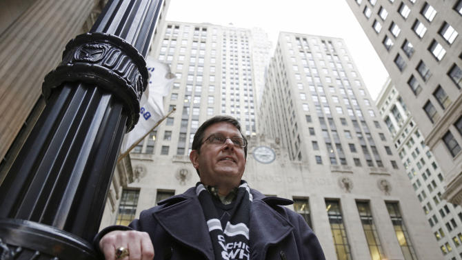 Sean Toohey, a grains broker at the Chicago Board of Trade, who had hip replacement surgery last summer ,walks home from work Monday, Feb. 11, 2013, in Chicago. Routine hip replacement surgery on a healthy patient may cost as little as $11,000 _ or up to nearly $126,000. Toohey said he has good health insurance that covered most of the costs, and it didn't occur to him to ask about price beforehand. (AP Photo/M. Spencer Green)
