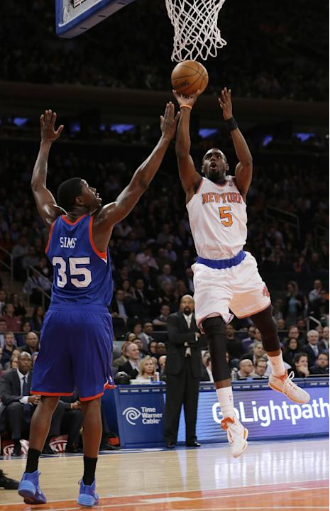 New York Knicks' Tim Hardaway Jr. (5) shoots over Philadelphia 76ers' Henry Sims (35) during the first half of an NBA basketball game Monday, March 10, 2014, in New York. (AP Photo/Frank Frank