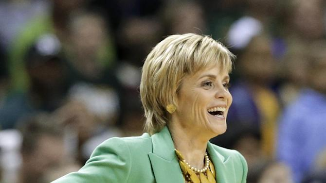 Baylor head coach Kim Mulkey smiles as she watches the team play against Texas in the second half of an NCAA college basketball game Saturday, Feb. 23, 2013, in Waco, Texas. Baylor defeated Texas 67-47. (AP Photo/Tony Gutierrez)