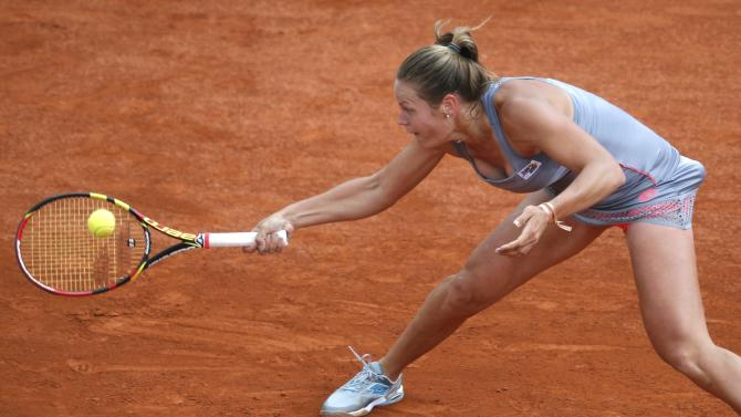 Karin Knapp of Italy plays a shot to Caroline Wozniacki of Denmark during their women's singles match at the French Open tennis tournament at the Roland Garros stadium in Paris