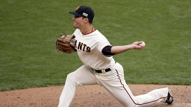 San Francisco Giants relief pitcher Javier Lopez throws against the St. Louis Cardinals during the 10th inning of Game 3 of the National League baseball championship series Tuesday, Oct. 14, 2014, in San Francisco. (AP Photo/Eric Risberg)