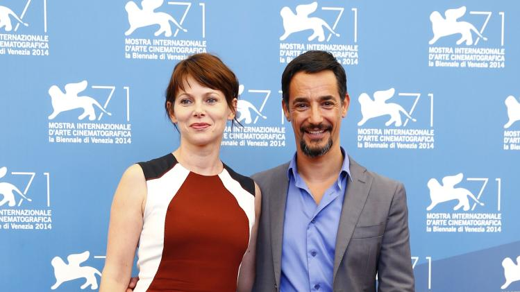 "Actor Peppino Mazzotta and actress Barbora Bobulova pose during the photo call for the movie ""Anime Nere"" (Black Souls) at the 71st Venice Film Festival"