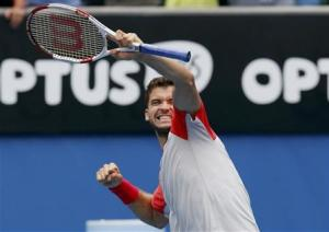 Grigor Dimitrov of Bulgaria celebrates defeating Milos Raonic of Canada during their men's singles match at the Australian Open 2014 tennis tournament in Melbourne