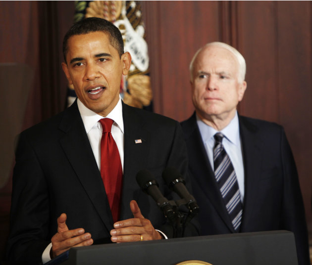 FILE - In this March 4, 2009 file photo, Sen. John McCain, R-Ariz., looks on as President Barack Obama makes remarks on government contracts reform in the Eisenhower Executive Office Building on the W