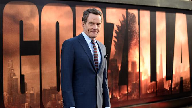 """FILE - This May 8, 2014 file photo shows Bryan Cranston at the premiere of """"Godzilla"""" in Los Angeles. Cranston plays a nuclear scientist who becomes obsessed with the cause of a 1999 destruction of a nuclear power plant. (Photo by Jordan Strauss/Invision/AP, File)"""