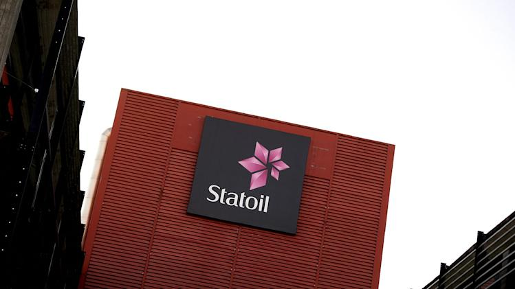 "FILE- The head office of Statoil in Stavanger, Norway, in this file photo dated Jan. 18, 2013.  The headquarters of Statoil in Stavanger were raided by anti-trust authorities on Tuesday May 14, 2013, investigating alleged price-fixing by oil companies including BP, Shell and Statoil.  A Commission launched by European anti-trust authorities to investigate concerns that oil companies ""may have colluded in reporting distorted prices"",  the commission said in a statement after unannounced inspections on Tuesday. (AP Photo / Kent Skibstad, NTB scanpix, File) NORWAY OUT"