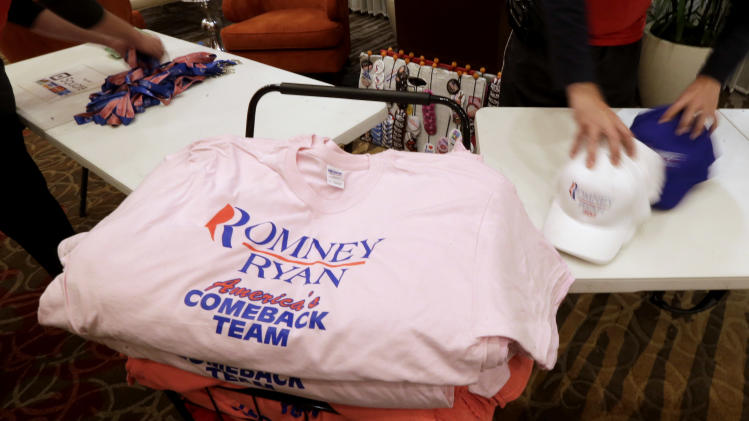 Vendors pack Romney Ryan merchandise after a watch party for U.S. Senate candidate, Rep. Todd Akin, R-Mo., Tuesday, Nov. 6, 2012, in Chesterfield, Mo. Akin lost the race to U.S. Sen. Claire McCaskill, D-Mo. (AP Photo/Charlie Riedel)