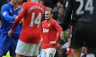 Manchester United&#39;s English forward Wayne Rooney (C) reacts at the final whistle after a 4-4 draw during the English Premier League football match between Manchester United and Everton at Old Trafford in Manchester