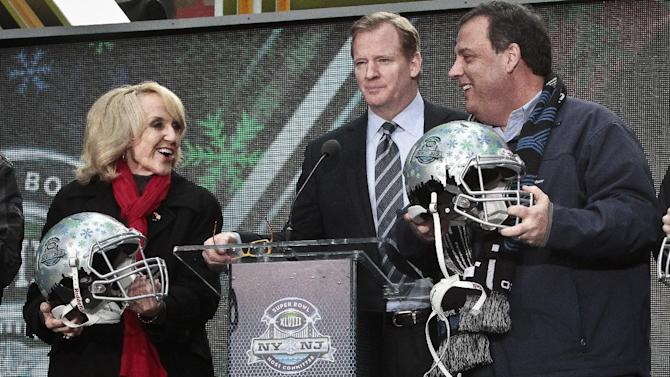 NFL Commissioner Roger Goodell, center, stands between Arizona Gov. Jan Brewer, left, and New Jersey Gov. Chris Christie, right, showoff souvenir football helmets after a ceremony to pass official hosting duties of next year's Super Bowl to Arizona, Saturday Feb. 1, 2014 in New York. (AP Photo/Bebeto Matthews)