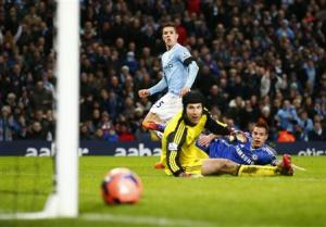 Manchester City's Jovetic scores a goal as Chelsea's Cech and Azpilicueta react during their English FA Cup fifth round soccer match at the Etihad Stadium in Manchester