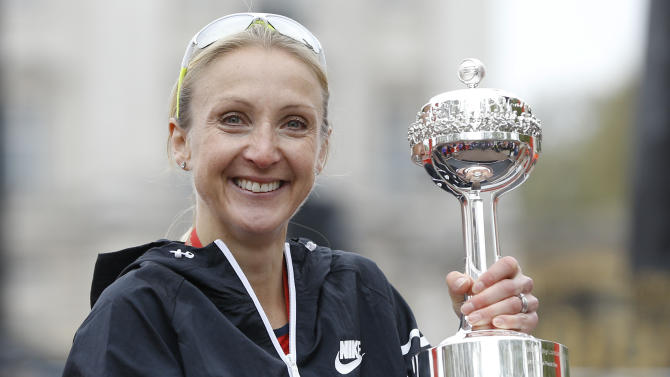 FILE- In this file photo dated Sunday, April 26, 2015, British athlete Paula Radcliffe after she was presented with a lifetime achievement award during the 35th London Marathon. The IAAF Friday Nov. 27, 2015  cleared marathon world record-holder Paula Radcliffe of doping allegations and rejected claims that it failed to act on hundreds of suspicious blood tests as lacking ``any scientific or legal basis.'' (AP Photo/Kirsty Wigglesworth, FILE)