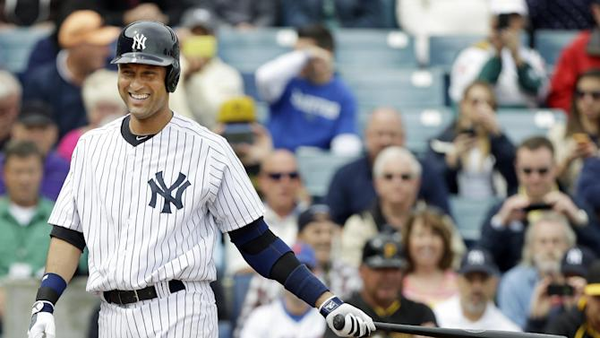New York Yankees shortstop Derek Jeter smiles as he walks to the plate during the first inning of an exhibition baseball game against the Pittsburgh Pirates Thursday, Feb. 27, 2014, in Tampa, Fla. (AP Photo/Charlie Neibergall)