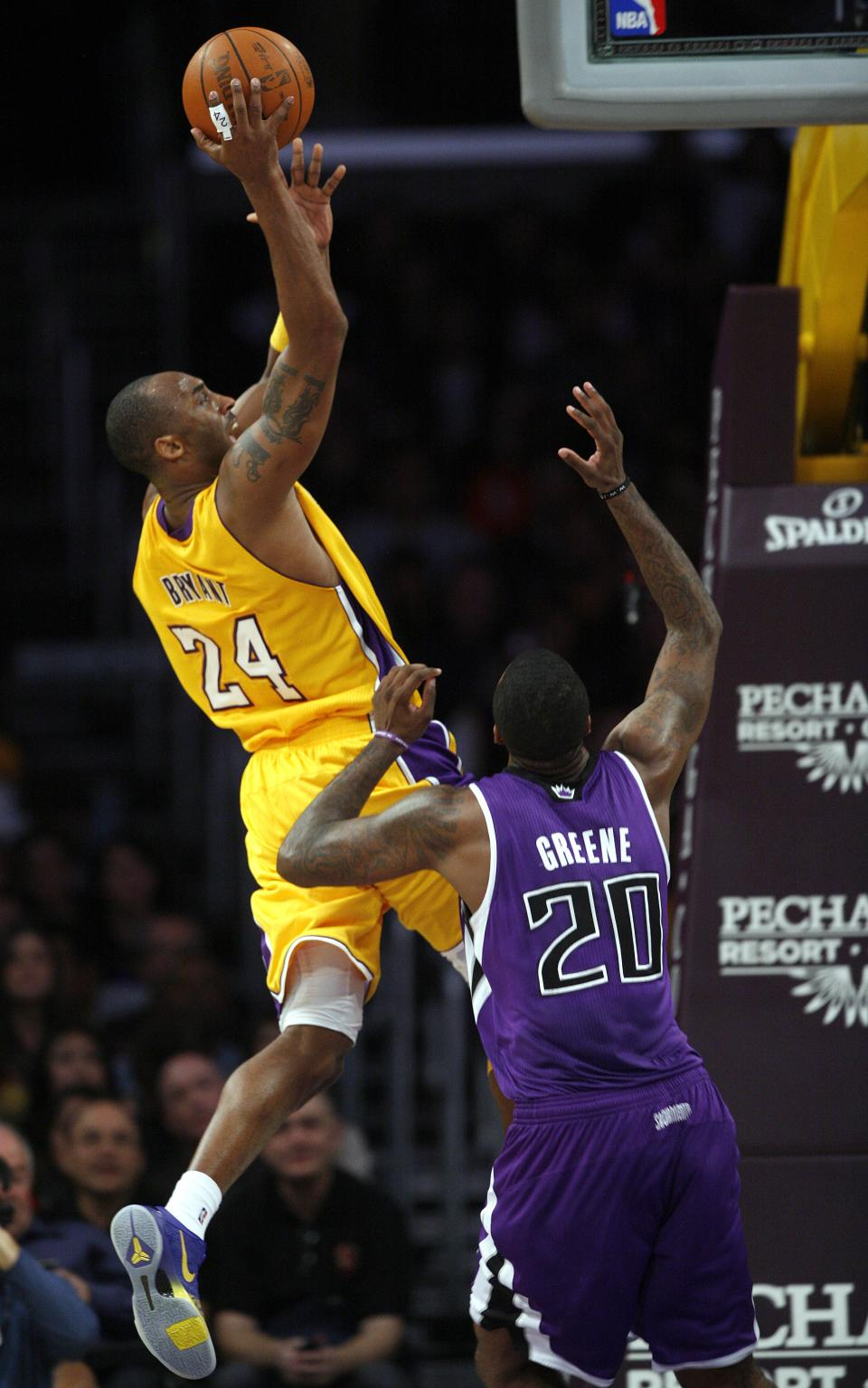Los Angeles Lakers guard Kobe Bryant (24) shoots as Sacramento Kings forward Donte Greene (20) defends during the first half of their NBA basketball game, Friday, Dec. 3, 2010, in Los Angeles. (AP Photo/Jason Redmond)