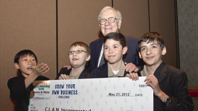"Berkshire Hathaway Chairman and CEO Warren Buffett poses for a photo in Omaha, Neb., Monday, May 21, 2012, with from left: Charles Chang, 11, of Rego Park, NY. Lucien Mount, 10, of Forest Hills, NY. Alejandro Astudillo, 10, of Forest Hills, NY. and Nataniel Natanov, 11, or Rego Park, NY. The four won $20,000 for their idea to sell school supplies and healthy snacks from a mobile store. Buffett devoted part of Monday to listen to a series of business ideas by entrepreneur youths aged 7- and 16-years-old who participated in the Grow Your Own Business contest associated with ""The Secret Millionaires Club"" cartoon that Buffett appears in. (AP Photo/Nati Harnik)"