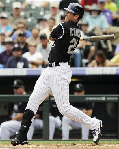 Scutaro lifts Rockies past Nationals in 11th