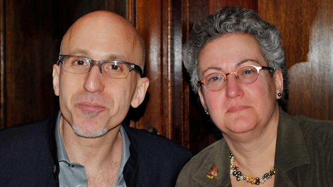 "This February 2010 photo provided by the family shows siblings Benjamin and Nancy Dreyer in New York. Nancy, a lesbian, says she has noticed the different ways society treats gay men and lesbians, partly because Benjamin is gay. The two say it's difficult to compare their experiences because he came out in college, and she in her early 30s. So he was the first to tell their parents. ""They yelled at me. They took you to dinner,"" Benjamin Dreyer, who's 54 and works in publishing in New York City, now jokes with his sister. (AP Photo/Nancy Dreyer)"