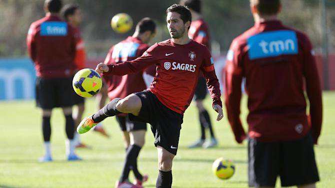 Portugal's midfielder Joao Moutinho kicks a ball during a training session near Obidos, Portugal, Tuesday, Nov. 12, 2013. The Portuguese soccer team will face Sweden on Friday in a qualifying play-off match for the 2014 World Cup