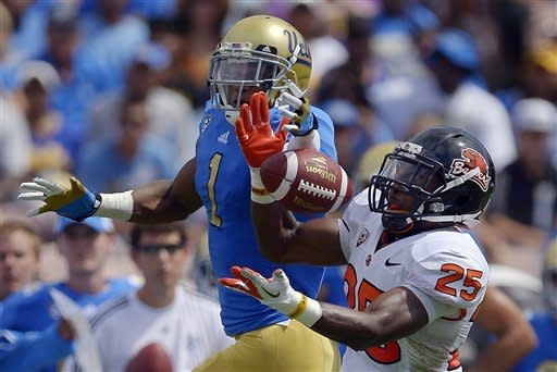 Mannion leads Beavers past Bruins 27-20