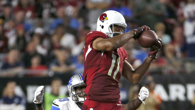 Cards' Fitzgerald says left knee 'a little better'