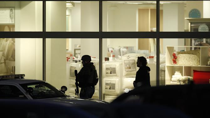 Law enforcement personnel work the scene of a shooting at the Clackamas Town Center in Clackamas, Ore. Tuesday, Dec. 11, 2012. A gunman opened fire at the Portland, Ore., area shopping mall Tuesday, killing at least one person and wounding an unknown number of others, sheriff's deputies said. (AP Photo/The Oregonian, Bruce Ely)  MAGS OUT; TV OUT; LOCAL TV OUT; LOCAL INTERNET OUT; THE MERCURY OUT; WILLAMETTE WEEK OUT; PAMPLIN MEDIA GROUP OUT