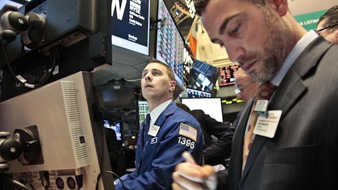 Joseph Mastrolia, left, a trader with Barclays, and Chris Casaliggi, Euronext floor manager, begin early trading on the floor of the New York Stock Exchange on Tuesday, Nov. 20, 2012.  (AP Photo/Bebeto Matthews)