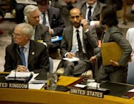 US Ambassador to the United Nations Susan Rice (R) leaves the Security Council chambers as Syria&#39;s Ambassador to the UN prepares to speak at United Nations Security Council meeting on Syria at the UN in New York. Rebels seized control of all of Syria&#39;s border crossings with Iraq, dealing a new blow to President Bashar al-Assad, as China and Russia dismayed the West by blocking UN action