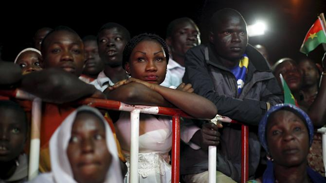 Supporters of President-elect Roch Marc Kabore watch election results at Kabore's campaign headquarters in Ouagadougou