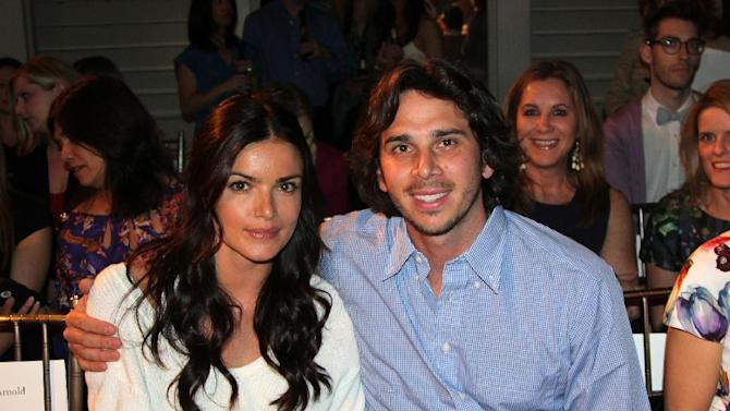 """Ben Flajnik, right, star of the ABC romance series """"The Bachelor,"""" and his fiancee Courtney Robinson pose before the Mark Zunino for Kleinfeld wedding fashion show, Monday, April 16, 2012 in New York. (AP Photo/Nicole Evatt)"""