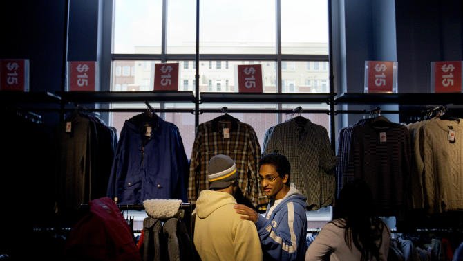 In this Wednesday, Dec. 12, 2012, photoChris Ghiathi, right, shops with friend Shawn Patel, left, in an H&M store, in Atlanta. Global clothing brands involved in Bangladesh's troubled garment industry responded in starkly different ways to the building collapse that killed more than 600 people. Some quickly acknowledged their links to the tragedy and promised compensation. Others denied they authorized work at factories in the building even when their labels were found in the rubble. (AP Photo/David Goldman)