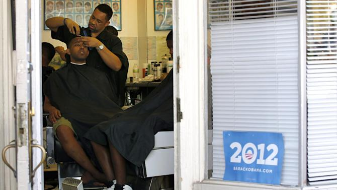 "Dorsey Jackson cuts Be-Emnet Zegeye's hair at his establishment Jackson's Barbershop, Friday, May 11, 2012, in Ardmore, Pa. Like many black Americans, Dorsey Jackson does not believe in gay marriage, but he wasn't disillusioned when Barack Obama became the first president to support it. The windows of his suburban Philadelphia barbershop still display an ""Obama 2012"" placard and another that reads ""We've Got His Back."" (AP Photo/Matt Rourke)"